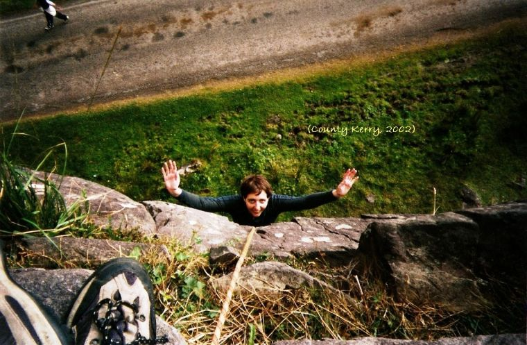Hanging off a rock in the Gap of Dunloe, County Kerry, Ireland in 2002