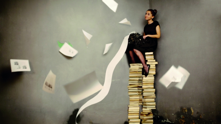 Girl on pile of books