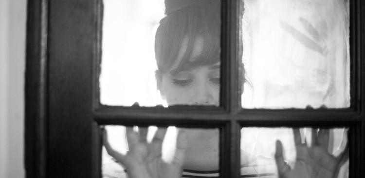 Girl glass door hands